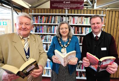 Lion President John Gee with the Chairman of the District Council and Manager of the Garden Centre at the official launch of the bookshop in their cafe.