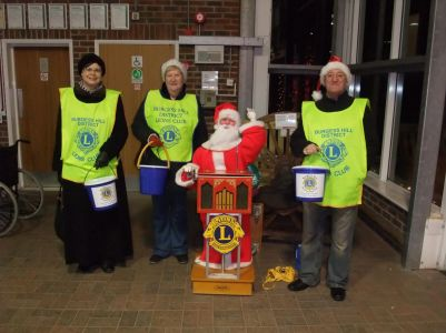 Santa and his Barrel Organ and Collectors