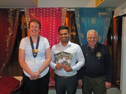 Lion President Sarah Dorrington and First Vice President John Carter with Mutahar Hussain of the Shapla