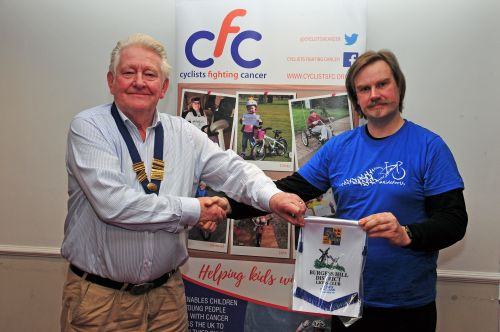 Presentation of bannerette to Matthew Shaw, manager of The Charity Bike Shop, Ditchling
