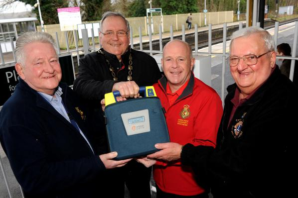 Lion President John Gee presenting defibrillator to Hassocks Station