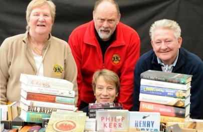 Lions members selling books at South Downs Garden Centre
