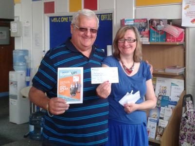 Secretary Lion Tony Parris, presenting a cheque for £540 towards transport costs to Liz, Treasurer of Mid Sussex Speak Up