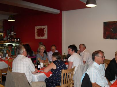 Members enjoying a meal at the Cafe Nazar